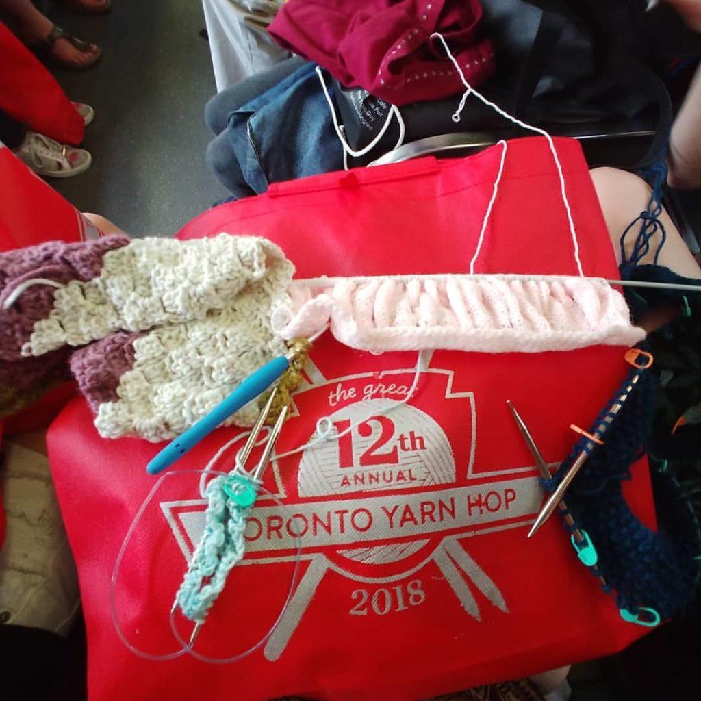 WIPs on a Yarn Hop tote bag.