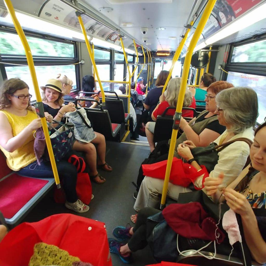 A team of yarn hoppers on a bus.