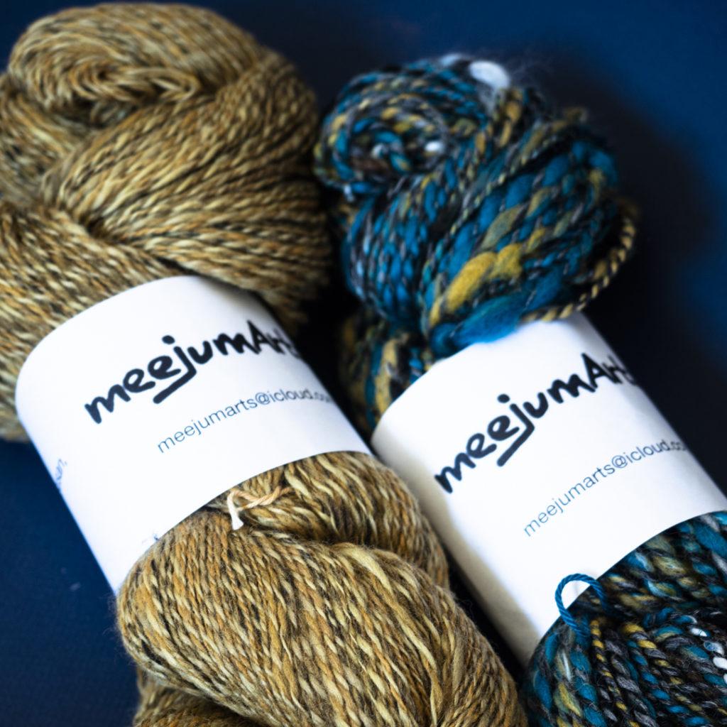 Two skeins of handspun wool.